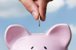 Münze und Sparschwein